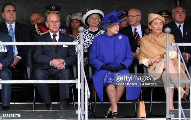 Queen Paola of Belgium Britain's Queen Elizabeth II the Duke of Edinburgh and Scotland's First Minister Alex Salmond are seen at the Tyne Cot War...