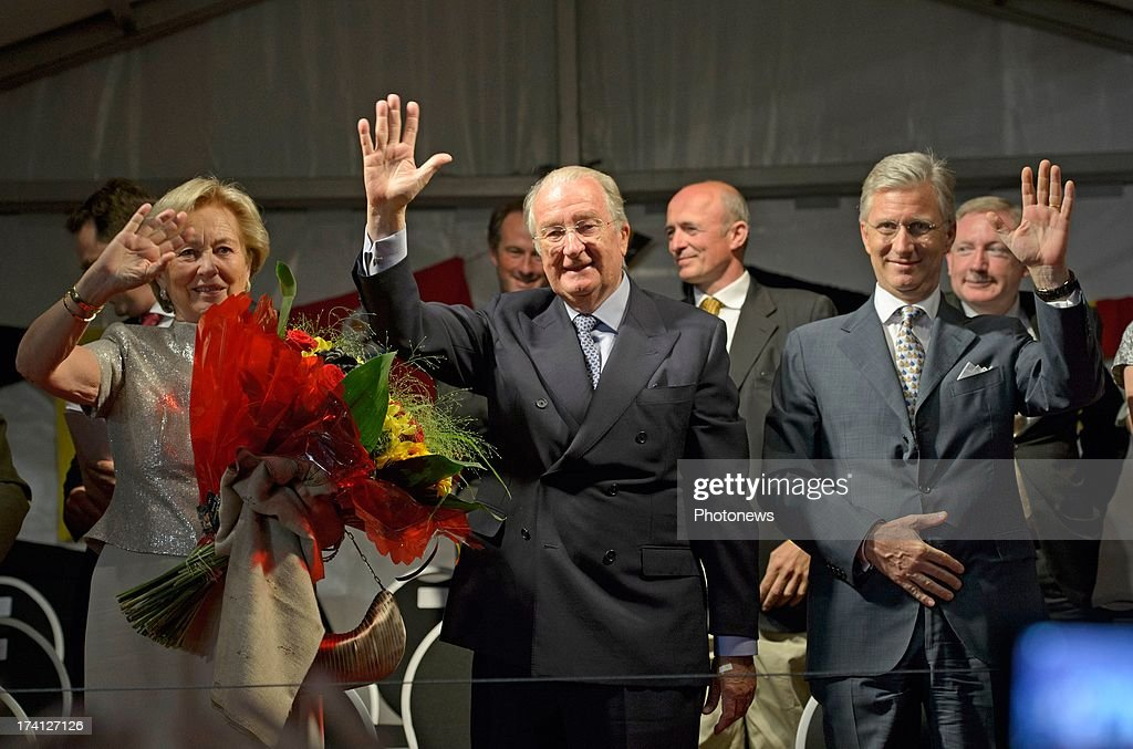 Queen Paola of Belgium, King <a gi-track='captionPersonalityLinkClicked' href=/galleries/search?phrase=Albert+II+of+Belgium&family=editorial&specificpeople=159444 ng-click='$event.stopPropagation()'>Albert II of Belgium</a> and Prince <a gi-track='captionPersonalityLinkClicked' href=/galleries/search?phrase=Philippe+of+Belgium&family=editorial&specificpeople=160209 ng-click='$event.stopPropagation()'>Philippe of Belgium</a> attend an evening of concerts the 'Bal National' in the Marolles neighbourhood of Brussels on July 20, 2013 in Brussels, Belgium. Tomorrow on Belgium's National Day King Albert II will abdicate in favour of his son Prince <a gi-track='captionPersonalityLinkClicked' href=/galleries/search?phrase=Philippe+of+Belgium&family=editorial&specificpeople=160209 ng-click='$event.stopPropagation()'>Philippe of Belgium</a>.
