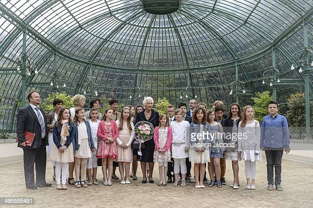 Queen Paola of Belgium poses with Ecole Communale d'Aawan Aywaille first laureate in a ceremony for the Queen Paola Education Award 20132014 at the...