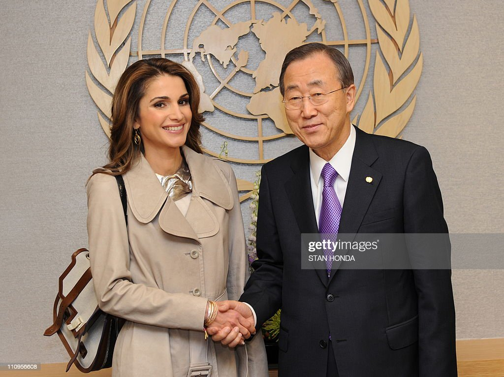 Queen Rania Al-Abdullah (L) of Jordan shakes hands with United Nations Secretary General Ban Ki-Moon (R) at UN headquarters in New York. AFP PHOTO/Stan HONDA
