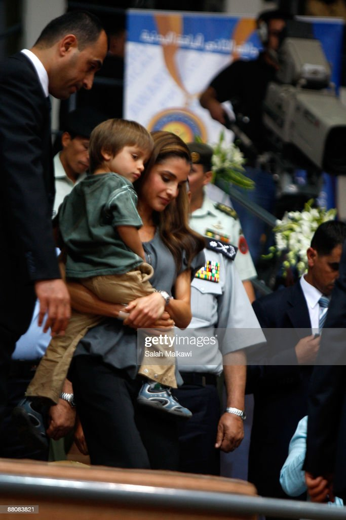 Queen Rania carries her son Prince Hashem bin Al Abdullah during The King Abdullah Award for Fitness ceremony on May 31, 2009 in Amman, Jordan.