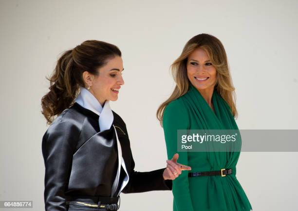 Queen Rania of Jordan and first lady Melania Trump walk along the Colonnade of the White House on April 5 2017 in Washington DC Later today President...