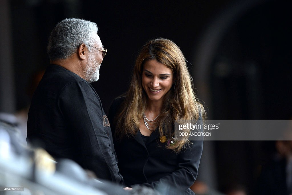 Queen Rania of Jordan and Ghana's former President Jerry Rawlings (L) arrive for the memorial service of South African former president Nelson Mandela at the FNB Stadium (Soccer City) in Johannesburg on December 10, 2013. Mandela, the revered icon of the anti-apartheid struggle in South Africa and one of the towering political figures of the 20th century, died in Johannesburg on December 5 at age 95.