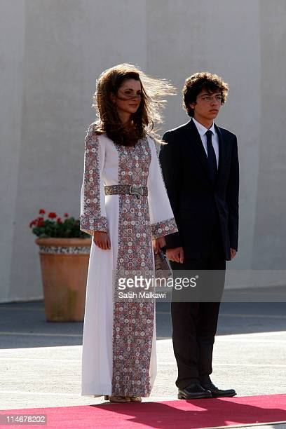 Queen Rania of Jordan and her son Crown Prince Hussein arrive at an official celebration for the 65th anniversary of Independence on May 25 2011 in...