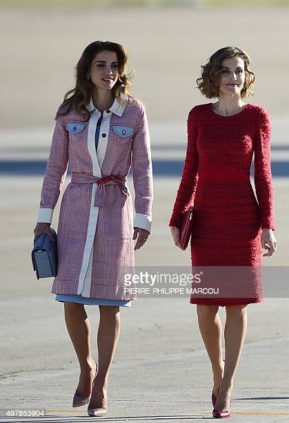 Queen Rania of Jordan and Queen Letizia of Spain walk together after arriving at Madrid's Barajas Adolfo Suarez airport on November 19 2015 AFP...