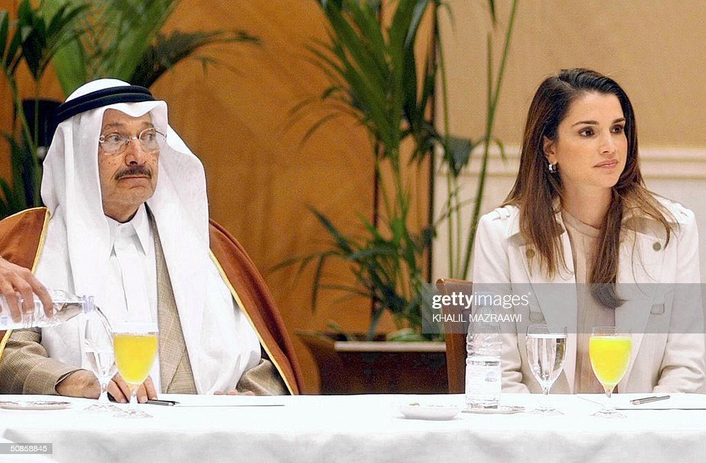Queen Rania of Jordan and Saudi Prince Talal bin Abul Aziz, a half brother of King Fahd and president of the Arab Gulf Program for United Nations Development Organizations (AGFUND), attend the signing ceremony of the National Bank for the funding of small businesses in Amman 19 May 2004. Th project was financed by AGFUND.