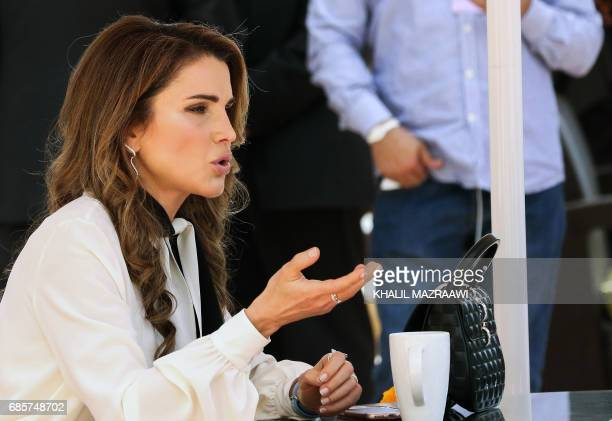 Queen Rania of Jordan attends the opening session of the World Economic Forum held in the Dead Sea resort of Shuneh west of the Jordanian capital...