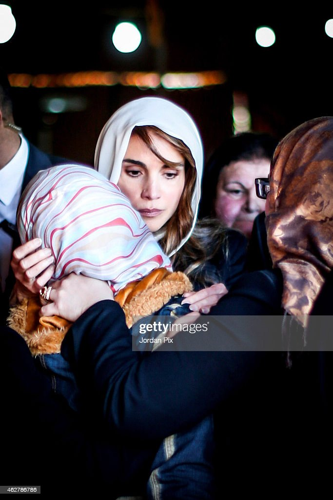Queen Rania of Jordan consoles Anwar Al Tarawneh, the wife of the Jordanian pilot Muath Al Kasasbeh, who was burned to death after being held hostage by Islamic State (IS) on February 5, 2015, in Aey, Jordan. Muath al-Kasaesbeh was captured by the terror group after crashing his plane near Raqqa in northern Syria, during a mission against IS in December.