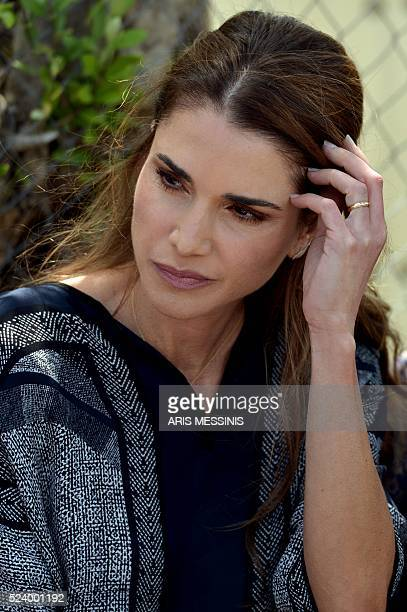Queen Rania of Jordan during her visit at the refugee site of Kara Tepe in Mytilene on April 25 2016 / AFP / ARIS MESSINIS
