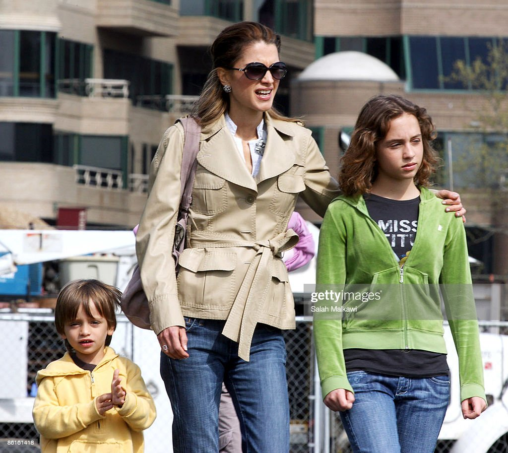queen-rania-of-jordan-enjoys-a-walk-with-her-son-prince-hashem-of-picture-id86161418