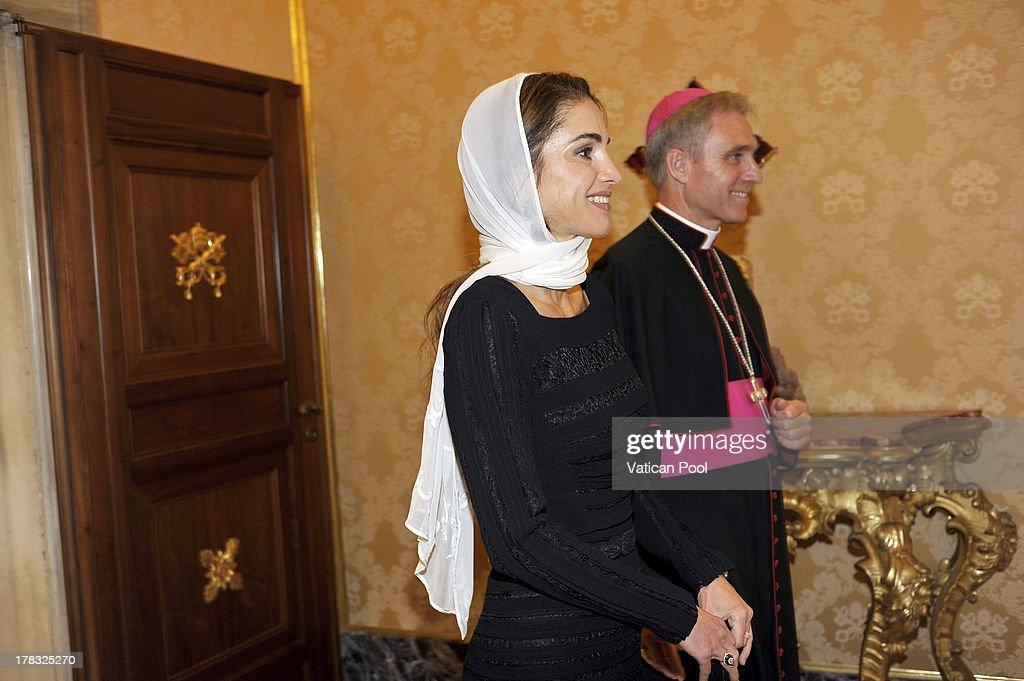 Queen Rania of Jordan, flanked by Prefect of the Pontifical House and former personal secretary of Pope Benedict XVI Georg Ganswein, arrives at the Pope's private library for a meeting with Pope Francis on August 29, 2013 in Vatican City, Vatican. The Pope was expected to talk about Jordan's sheltering of those fleeing the civil war in neighboring Syria.