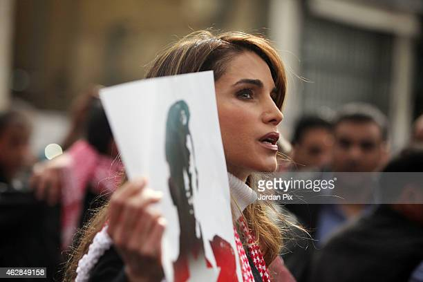 Queen Rania of Jordan participates in a mass demonstration after Friday prayers near Al Hussein Mosque to express her solidarity with the pilot...
