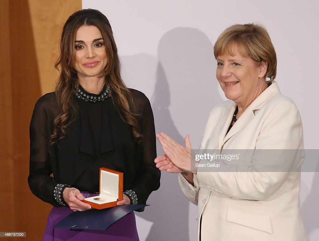 Queen Rania of Jordan (L) smiles after receiving the Walther Rathenau Award by German Chancellor <a gi-track='captionPersonalityLinkClicked' href=/galleries/search?phrase=Angela+Merkel&family=editorial&specificpeople=202161 ng-click='$event.stopPropagation()'>Angela Merkel</a> on September 17, 2015 in Berlin, Germany. The award is in recognition of foreign policy achievements and Queen Rania's efforts on behalf of refugees and children.