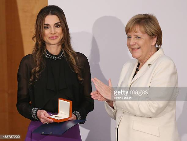 Queen Rania of Jordan smiles after receiving the Walther Rathenau Award by German Chancellor Angela Merkel on September 17 2015 in Berlin Germany The...