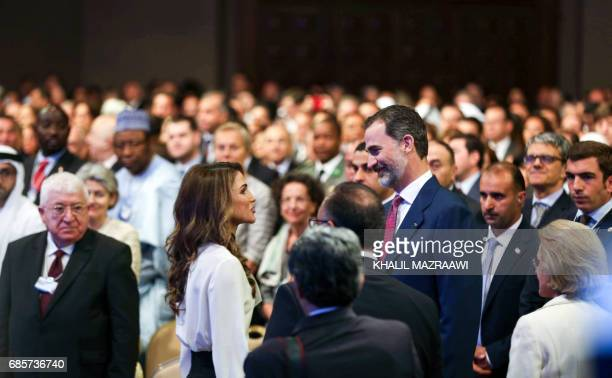 Queen Rania of Jordan speaks with King Felipe VI of Spain during the opening session of the World Economic Forum held in the Dead Sea resort of...
