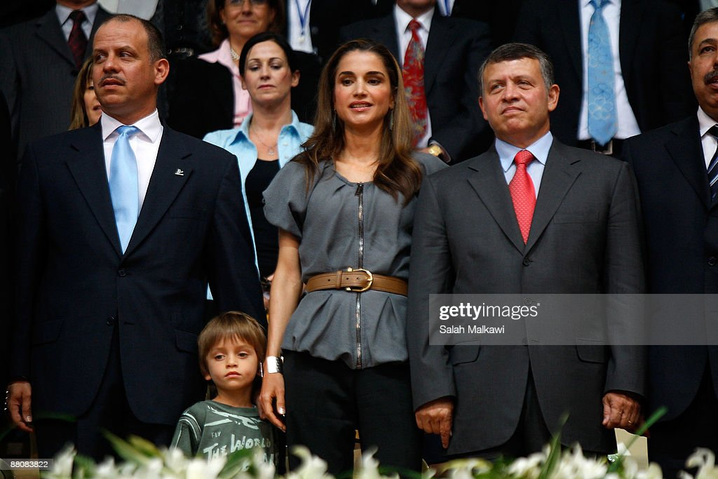 Queen Rania of Jordan (2R) stands with her son Prince Hashem bin Al Abdullah (2L) between King Abdullah II of Jordan (R) and his brother Prince Faisal Bin Al Hussein during The King Abdullah Award for Fitness ceremony on May 31, 2009 in Amman, Jordan.