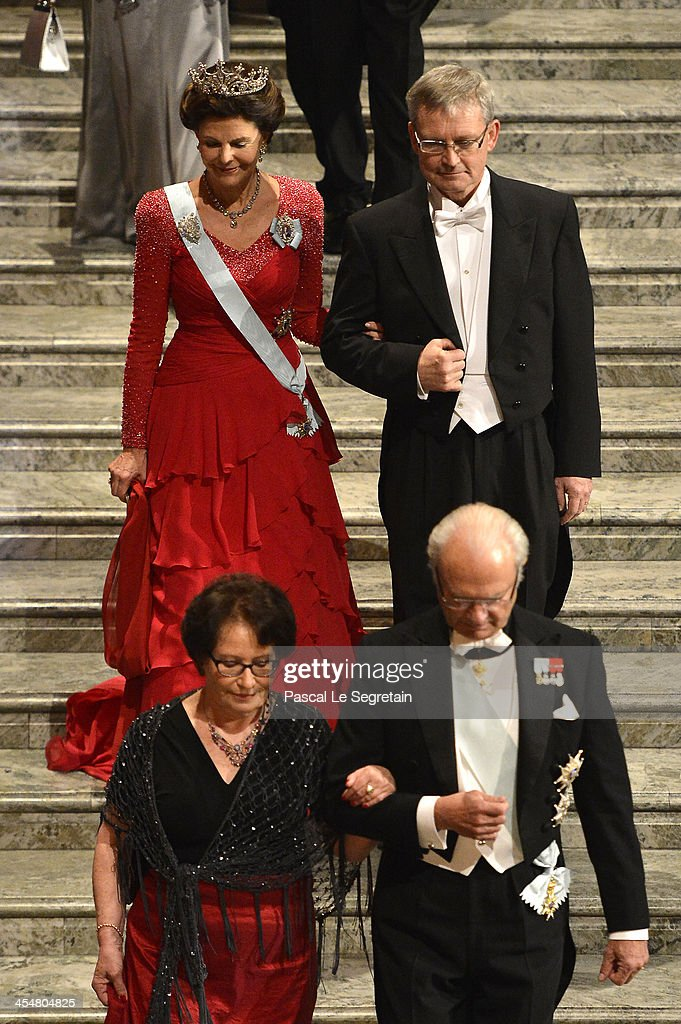 <a gi-track='captionPersonalityLinkClicked' href=/galleries/search?phrase=Queen+Silvia+of+Sweden&family=editorial&specificpeople=160332 ng-click='$event.stopPropagation()'>Queen Silvia of Sweden</a> and Chairman of the Board of the Nobel Foundation, Professor Carl-Henrik Heldin, and (1st row R) King Carl Gustaf XIV of Sweden and his dinner companion attend the Nobel Prize Banquet after the 2013 Nobel Prize Awards Ceremony at City Hall on December 10, 2013 in Stockholm, Sweden.