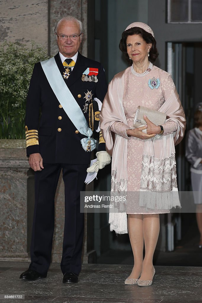 Queen Silvia of Sweden and King Carl Gustaf of Sweden are seen after the christening of Prince Oscar of Sweden at Royal Palace of Stockholm on May 27, 2016 in Stockholm, Sweden.