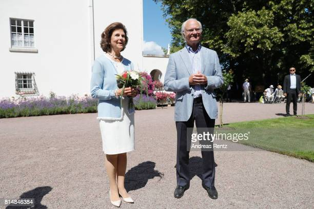 Queen Silvia of Sweden and King Carl Gustaf of Sweden are seen meeting the people gathered in front of Solliden Palace to celebrate the 40th birthday...