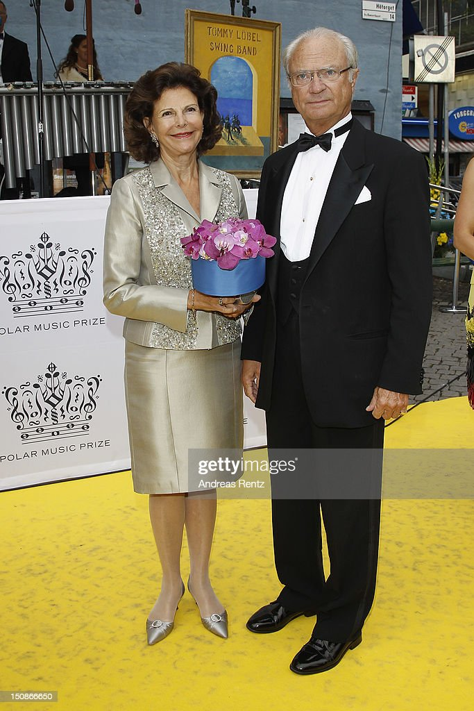 Queen Silvia of Sweden and King <a gi-track='captionPersonalityLinkClicked' href=/galleries/search?phrase=Carl+XVI+Gustaf&family=editorial&specificpeople=159449 ng-click='$event.stopPropagation()'>Carl XVI Gustaf</a> of Sweden arrive for the Polar Music Prize at Konserthuset on August 28, 2012 in Stockholm, Sweden.