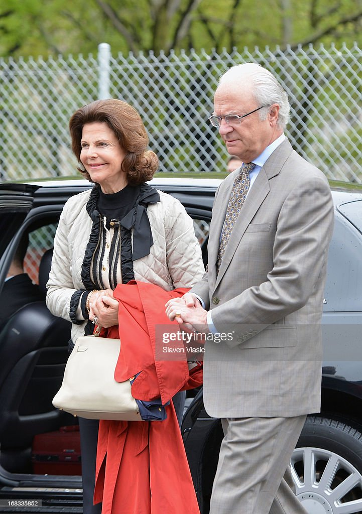 Queen Silvia of Sweden and King Carl XVI Gustaf of Sweden visit Castle Clinton National Monument at Battery Park on May 8, 2013 in New York City.