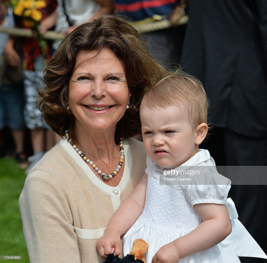 <a gi-track='captionPersonalityLinkClicked' href=/galleries/search?phrase=Queen+Silvia+of+Sweden&family=editorial&specificpeople=160332 ng-click='$event.stopPropagation()'>Queen Silvia of Sweden</a> and <a gi-track='captionPersonalityLinkClicked' href=/galleries/search?phrase=Princess+Estelle&family=editorial&specificpeople=8948207 ng-click='$event.stopPropagation()'>Princess Estelle</a> of Sweden (R) attend Victoria Day celebrations at Solliden Castle on July 14, 2013 in Borgholm, Sweden.
