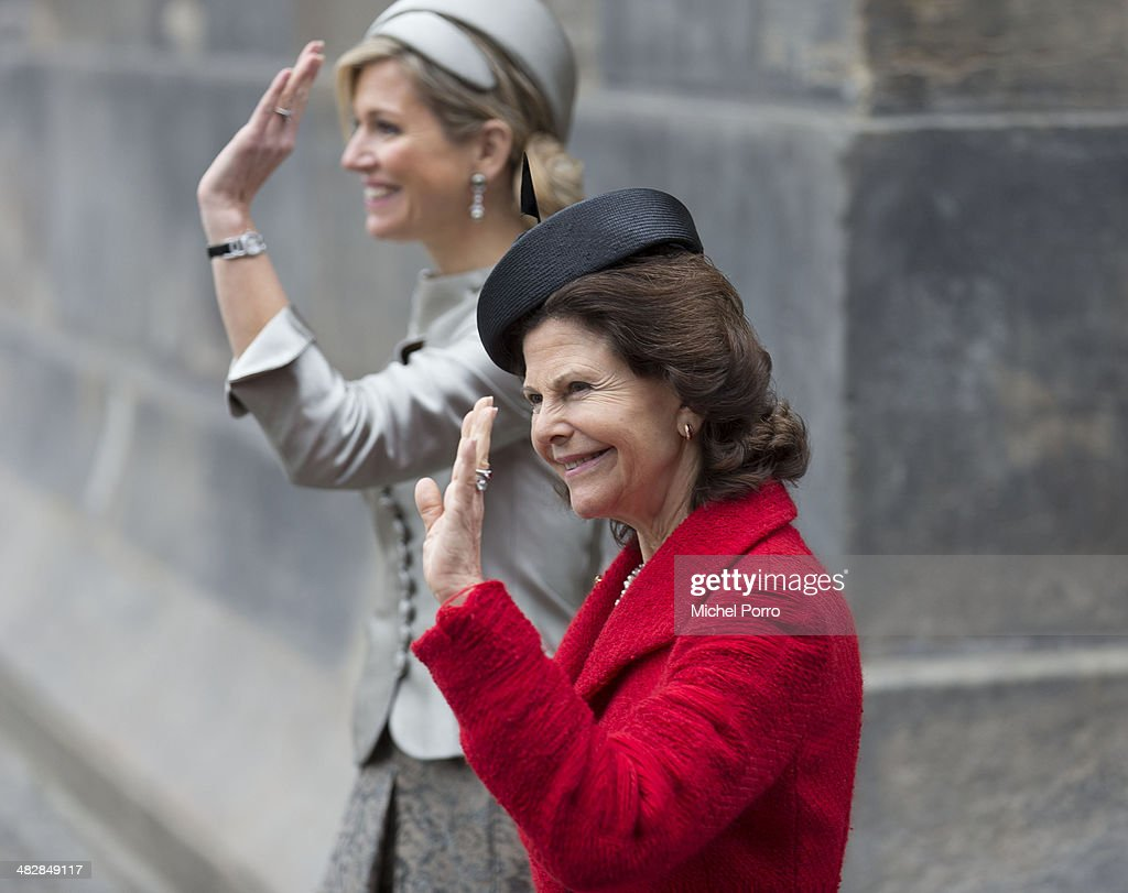 Queen Silvia of Sweden (R) and Queen Maxima of The Netherlands at the start of an official two day visit to Holland on April 4, 2014 in Amsterdam, Netherlands.
