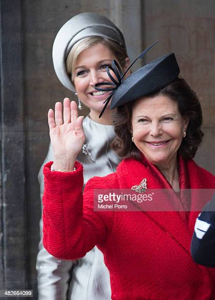 Queen Silvia of Sweden and Queen Maxima of The Netherlands wave to the crowd at the Royal Palace at the start of an official two day Visit Holland on...
