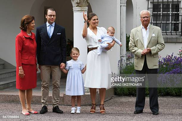 Queen Silvia of Sweden Crown Prince Daniel Princess Estelle Crown Princess Victoria holding Prince Oscar and King Carl XVI Gustaf of Sweden greet the...