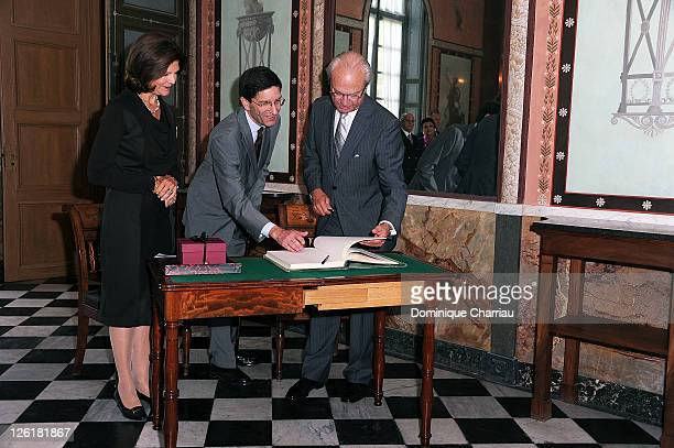 Queen Silvia of Sweden curator of the Chateau de Malmaison Amaury Lefebure and King Carl Gustaf of Sweden visit the Musee National Des Chateaux de...