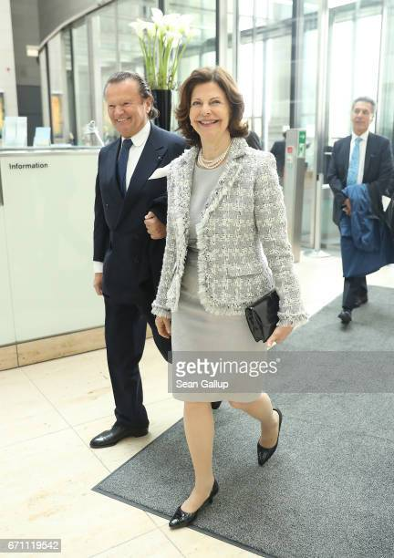 Queen Silvia of Sweden enters the Reichstag following a group photo with members of the World Scout Foundation on the steps of the Reichstag during a...