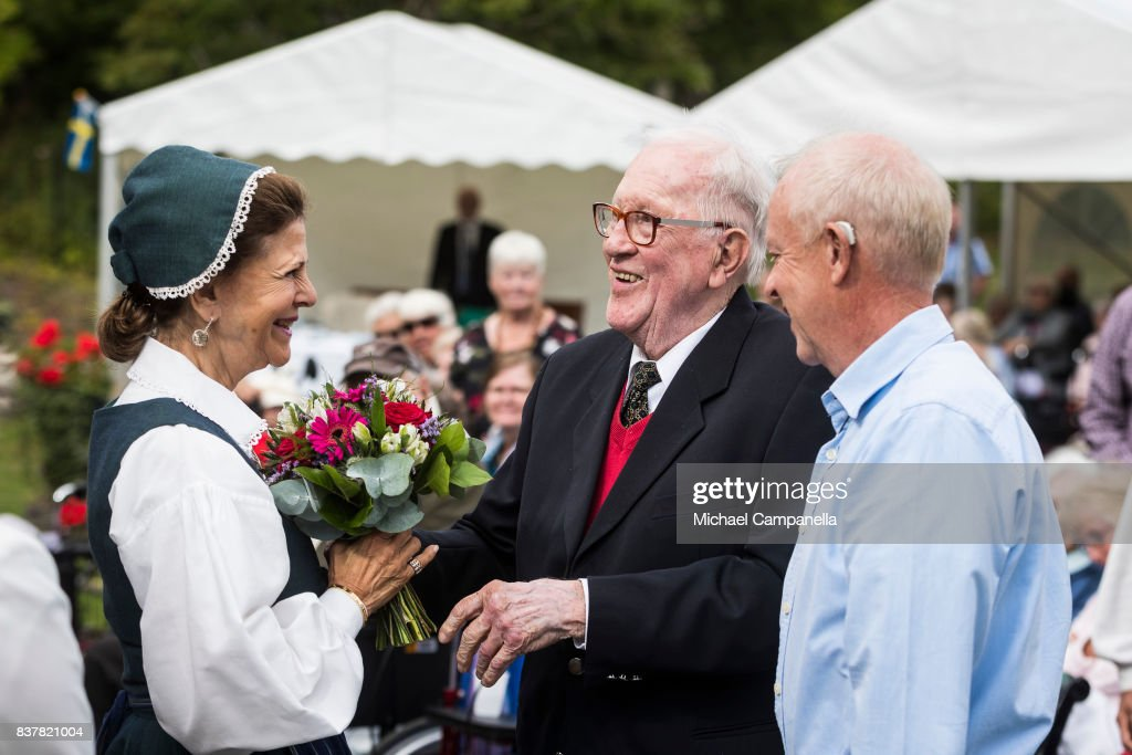 Queen Silvia of Sweden greets 92 year old Villy Johansson a pensioners day at Ekebyhovs Castle on August 23, 2017 in Stockholm, Sweden.