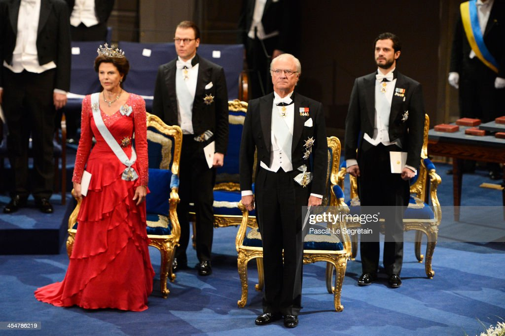 <a gi-track='captionPersonalityLinkClicked' href=/galleries/search?phrase=Queen+Silvia+of+Sweden&family=editorial&specificpeople=160332 ng-click='$event.stopPropagation()'>Queen Silvia of Sweden</a>, Prince Daniel of Sweden, King Carl XVI Gustaf of Sweden and <a gi-track='captionPersonalityLinkClicked' href=/galleries/search?phrase=Prince+Carl+Philip+of+Sweden&family=editorial&specificpeople=160179 ng-click='$event.stopPropagation()'>Prince Carl Philip of Sweden</a> attend the Nobel Prize Awards Ceremony at Concert Hall on December 10, 2013 in Stockholm, Sweden.