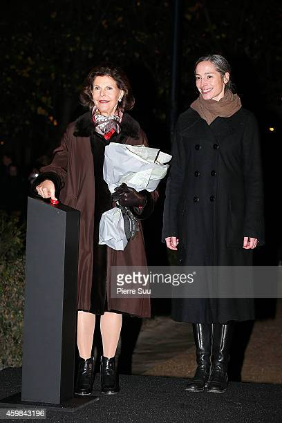 Queen Silvia of Sweden switches on the 'Northern light' instalation by swedish artist Aleksandra Stratimirovic at the Palais Royal Garden on December...