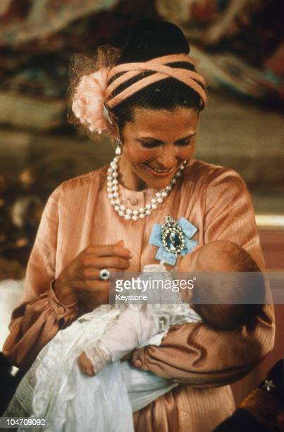 Queen Silvia of Sweden with baby Prince Carl Philip during his christening held at the Royal Chapel in Stockholm on August 31 1979