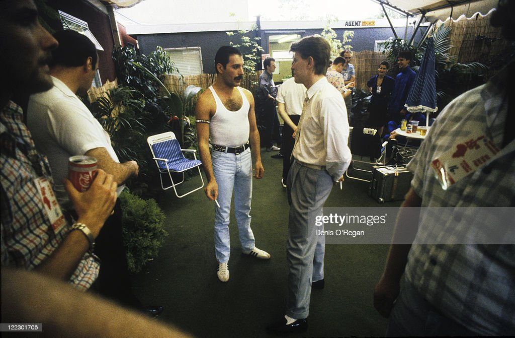 Queen singer Freddie Mercury and David Bowie talking backstage at the Live Aid concert, Wembley Stadium, London, 13th July 1985.