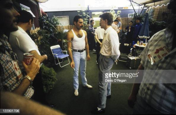 Queen singer Freddie Mercury and David Bowie talking backstage at the Live Aid concert Wembley Stadium London 13th July 1985