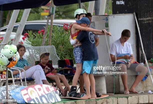 Queen Sofia and her grandsons Juan Valentin Urdangarin Pablo Nicolas Urdangarin Miguel Urdangarin and Irene Urdangarin are seen on July 24 2017 in...