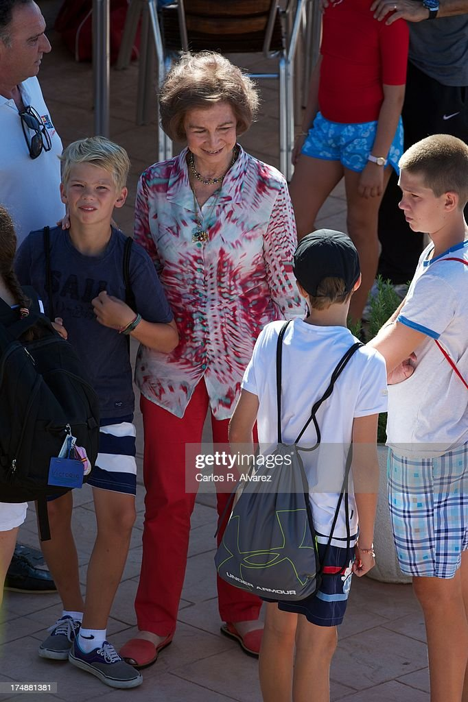Queen Sofia of Spain (C) and her grandsons (L-R) Pablo Nicolas Urdangarin, Miguel Urdangarin and Juan Valentin Urdangarin arrive at Calanova Sailing School on July 29, 2013 in Palma de Mallorca, Spain.