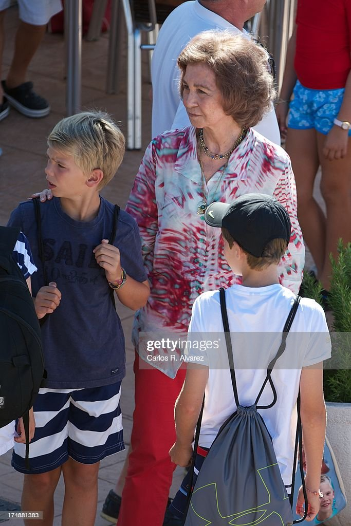 Queen Sofia of Spain (C) and her grandsons (L-R) Pablo Nicolas Urdangarin and Miguel Urdangarin arrive at Calanova Sailing School on July 29, 2013 in Palma de Mallorca, Spain.