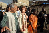Queen Sofia of Spain chat on April 7 2010 with Nobel peace prize laureate Muhammad Yunus of Bangladesh as she tours the Mathare slum of Nairobi where...