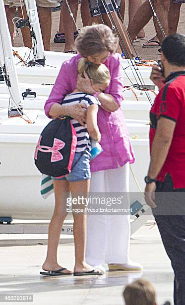 Queen Sofia of Spain is seen speaking to her grandaughter Irene Urdangarin on July 30 2014 in Palma de Mallorca Spain