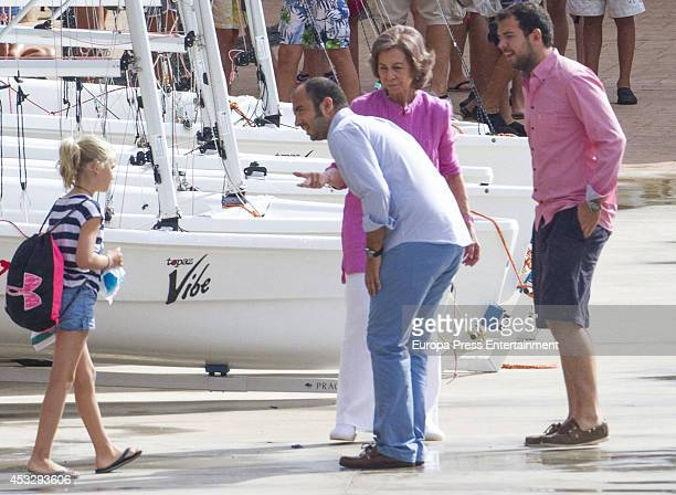 Queen Sofia of Spain is seen speaking to the sailing course teacher and her grandaughter Irene Urdangarin on July 30 2014 in Palma de Mallorca Spain