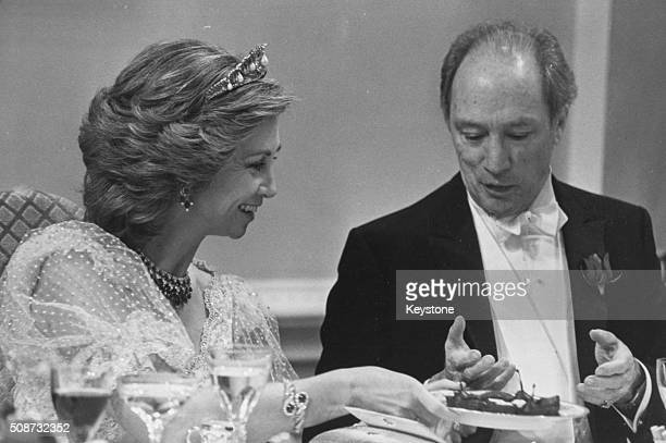 Queen Sofia of Spain offering sweets to Canadian Prime Minister Pierre Trudeau at a gala dinner in Ottawa circa 1975