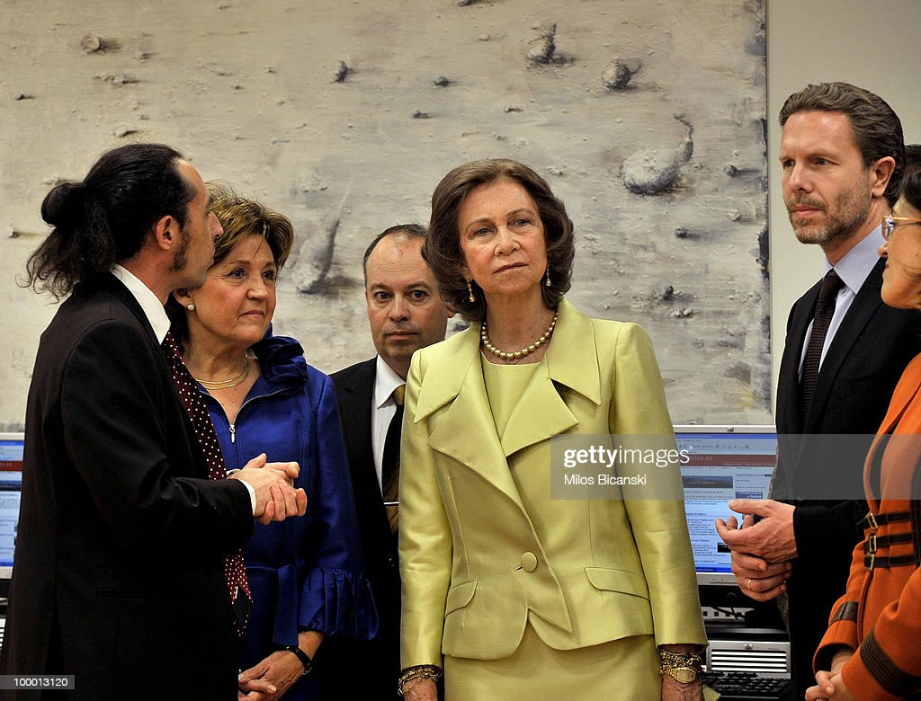 Queen Sofia of Spain talks with Greek Culture Minister Pavlos Geroulanos (R) and chairman of Cervantes Institute Eusebi Ayensa Prat (back) while they visit the library as the Queen inaugurates the new building of the Cervantes Institute in central Athens, on May 19, 2010 in Athens, Greece. The Cervantes Institute was created to promote the Spanish language and culture. Queen Sofia was visiting the Institute during a two-day visit in Greece.
