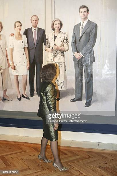 Queen Sofia of Spain watches the painting titled 'King Juan Carlos I's Family' by Spanish painter Antonio Lopez during 'El Retrato en las Colecciones...
