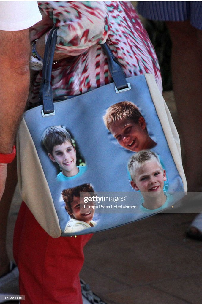 <a gi-track='captionPersonalityLinkClicked' href=/galleries/search?phrase=Queen+Sofia+of+Spain&family=editorial&specificpeople=160333 ng-click='$event.stopPropagation()'>Queen Sofia of Spain</a>'s handbag with her four grandsons pictured in Mallorca on July 29, 2013 in Mallorca, Spain. Princess Cristina of Spain comes back to Mallorca after two years.
