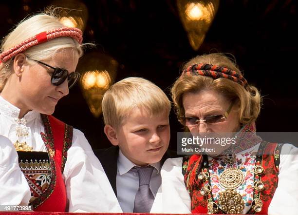 Queen Sonja of Norway and Crown Princess MetteMarit of Norway with Prince Sverre Magnus watch the National Day Childrens Parade from the Royal Palace...