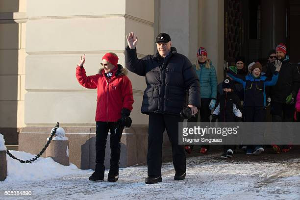 Queen Sonja of Norway and King Harald V of Norway walk outside the Royal Palace while celebrating the 25th anniversary of King Harald V and Queen...