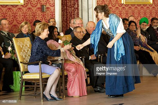 Queen Sonja of Norway attends a guided tour at the Oslo City Hall during the first day of the state visit from India on October 13 2014 in Oslo Norway